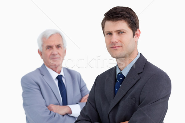 Close up of young businessman with his mentor behind him against a white background Stock photo © wavebreak_media