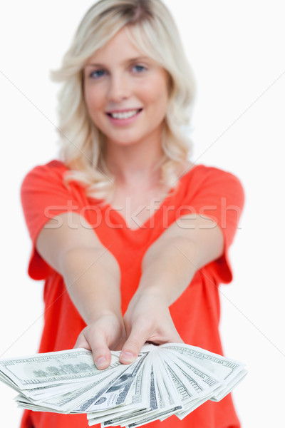 Fan of dollar banknotes held by a smiling young blonde woman  Stock photo © wavebreak_media