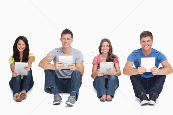 Grupo de personas tableta manos todo mirar Foto stock © wavebreak_media
