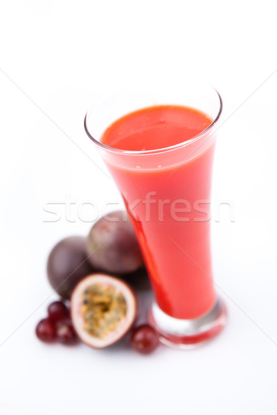 Passion fruits next to a glass against white background Stock photo © wavebreak_media