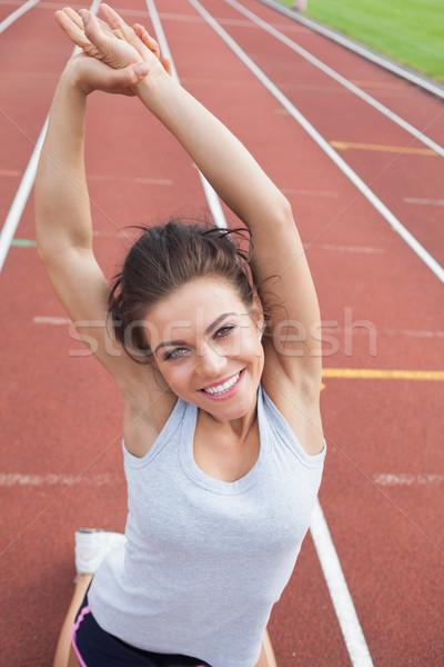 Mulher seguir estádio brasão esportes Foto stock © wavebreak_media