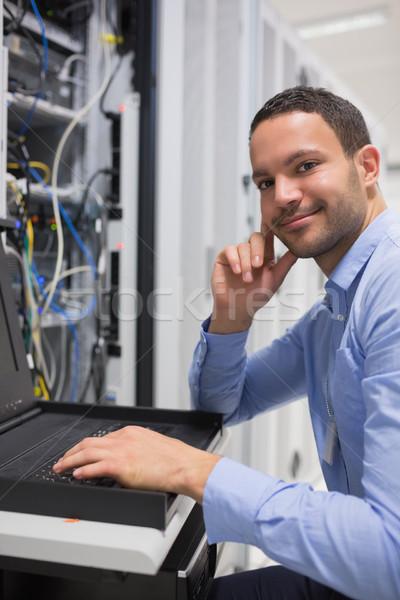 Happy man working with servers in data center Stock photo © wavebreak_media