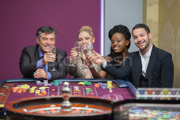 Four people toasting with champagne at roulette in casino Stock photo © wavebreak_media