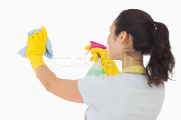 Brunetter woman spraying and wiping in rubber gloves Stock photo © wavebreak_media