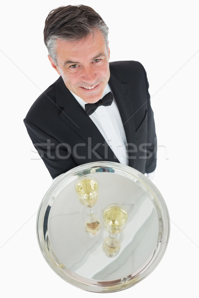 Waiter standing with silver tray of champagne flutes Stock photo © wavebreak_media