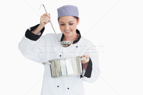 Happy cook with a ladle and a pot on white background Stock photo © wavebreak_media