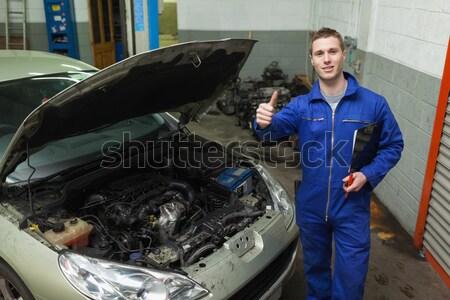 Confident auto mechanic by car Stock photo © wavebreak_media