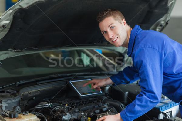 Confident mechanic using digital tablet Stock photo © wavebreak_media