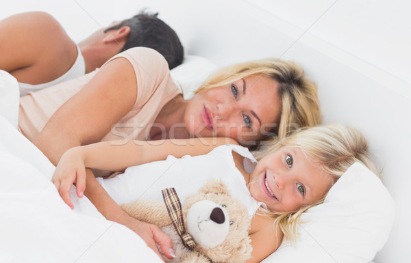 Family lying together on a bed Stock photo © wavebreak_media