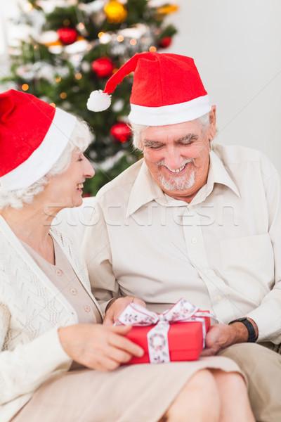 Elderly couple swapping christmas presents Stock photo © wavebreak_media