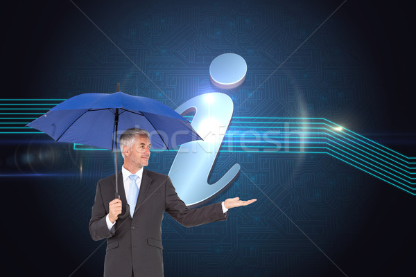 Composite image of happy businessman holding umbrella Stock photo © wavebreak_media