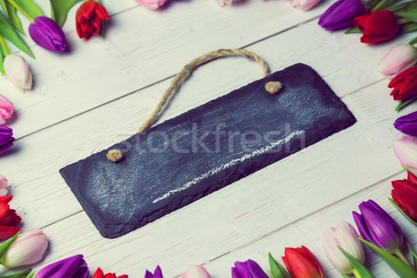 Tulips forming frame around chalkboard Stock photo © wavebreak_media