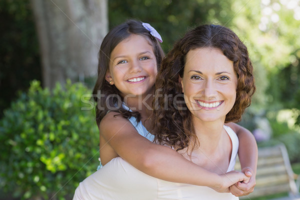 Happy mother and daughter embracing  Stock photo © wavebreak_media
