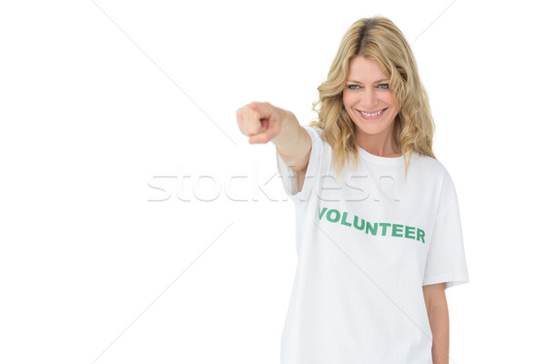 Portrait of a happy female volunteer pointing at you Stock photo © wavebreak_media