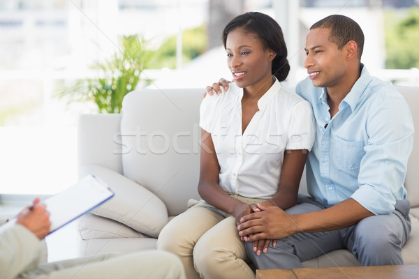Young couple listening to salesman on the couch Stock photo © wavebreak_media