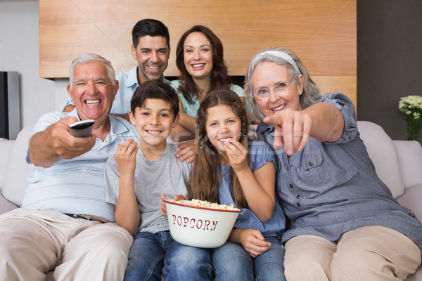 Portrait of happy extended family watching tv in living room Stock photo © wavebreak_media