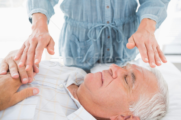 Man having Reiki treatment by therapist Stock photo © wavebreak_media