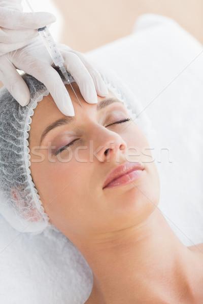 Mulher injeção de botox bela mulher testa escritório Foto stock © wavebreak_media