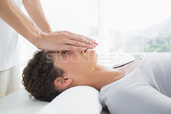 Attractive woman having reiki treatment Stock photo © wavebreak_media