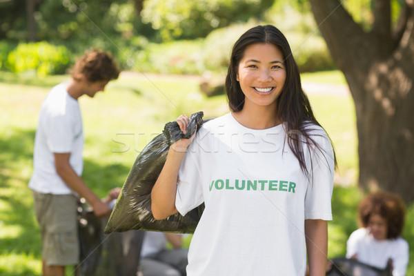 Team of volunteers picking up litter in park Stock photo © wavebreak_media