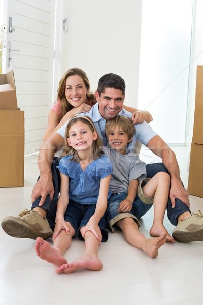 Family sitting on floor in new house Stock photo © wavebreak_media