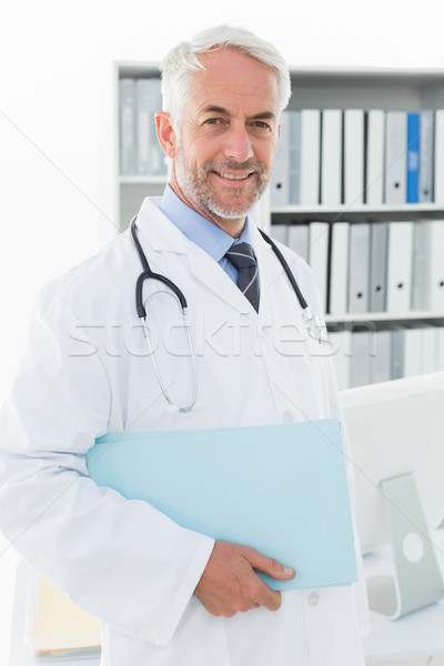 Portrait of a smiling male doctor at medical office Stock photo © wavebreak_media