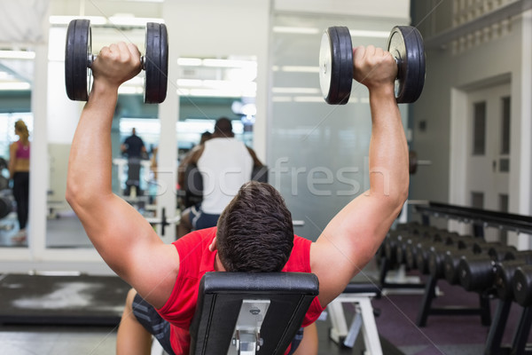 Bodybuilder banc haltères gymnase femme Photo stock © wavebreak_media