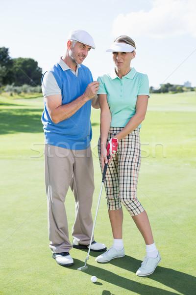 Man coaching his partner on the putting green Stock photo © wavebreak_media