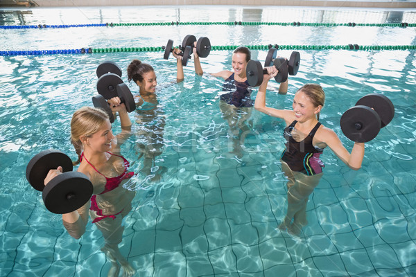 Sonriendo femenino fitness clase agua aerobic Foto stock © wavebreak_media