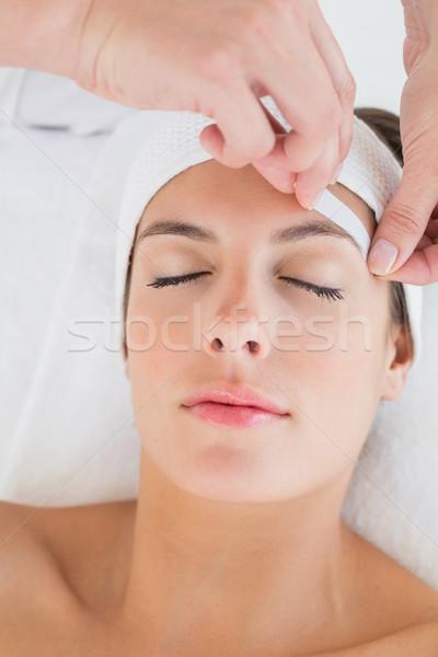 Mão depilação com cera belo sobrancelha mulher Foto stock © wavebreak_media