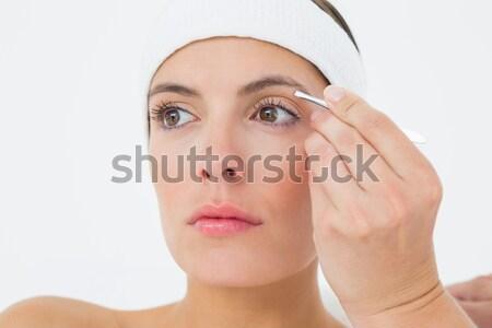 Coppia guardando carta strappata bianco donna carta Foto d'archivio © wavebreak_media