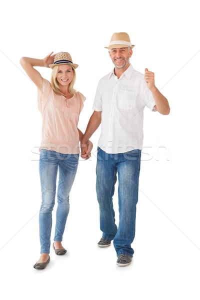 счастливым пару ходьбе , держась за руки белый женщину Сток-фото © wavebreak_media