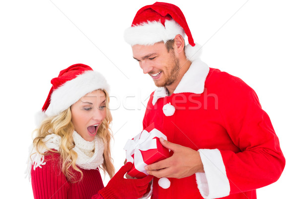 Festive young couple exchanging presents Stock photo © wavebreak_media