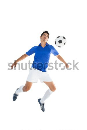 Fit player kicking football Stock photo © wavebreak_media