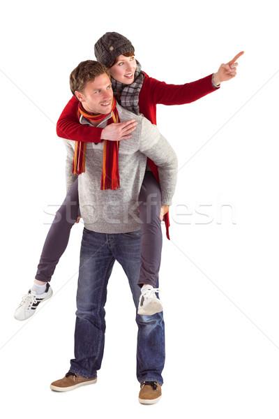 Man giving girlfriend piggy back Stock photo © wavebreak_media