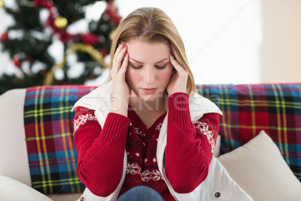 Pretty blonde woman having a headache on the sofa Stock photo © wavebreak_media