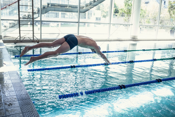 Swimmer diving into the pool at leisure center Stock photo © wavebreak_media