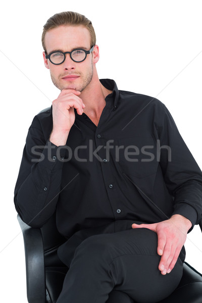 Businessman sitting on an office chair with hand on chin Stock photo © wavebreak_media