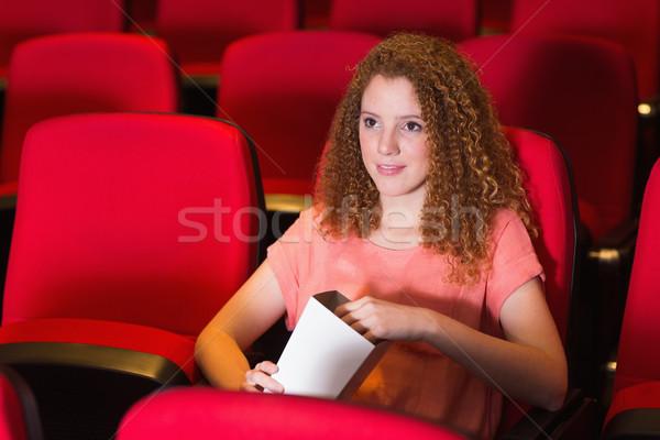 Fiatal nő néz film mozi film szék Stock fotó © wavebreak_media