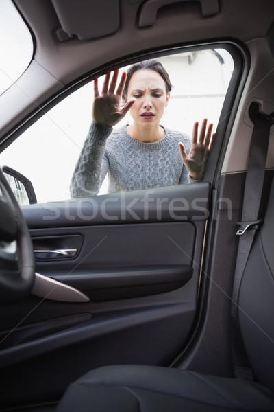 Sad woman looking inside the car Stock photo © wavebreak_media
