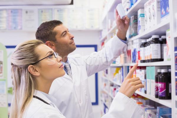 Team of pharmacists looking at medicine  Stock photo © wavebreak_media