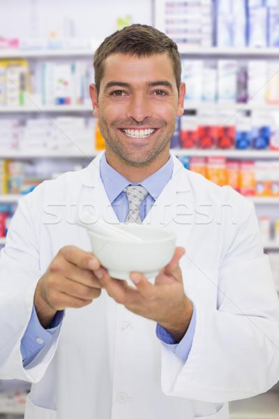 Smiling pharmacist mixing a medicine Stock photo © wavebreak_media