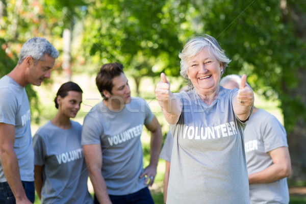 Happy volunteer grandmother with thumbs up  Stock photo © wavebreak_media