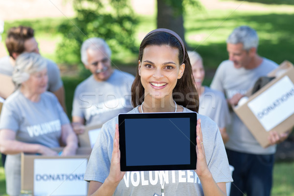 Sonriendo voluntario morena Screen Foto stock © wavebreak_media