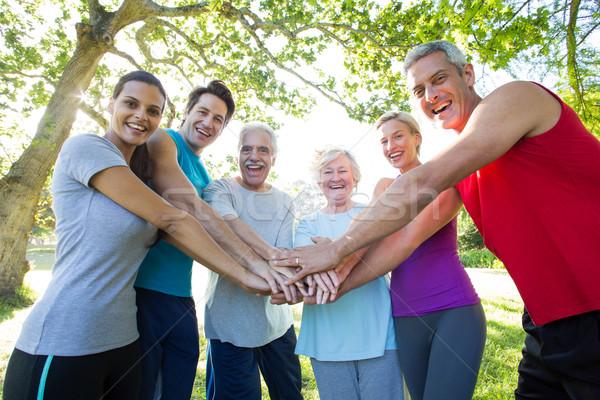 счастливым спортивный группа рук вместе Сток-фото © wavebreak_media