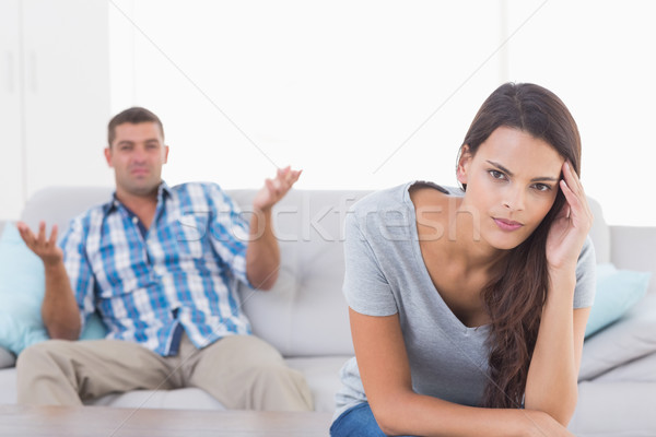 Stock photo: Woman suffering from headache while man quarreling