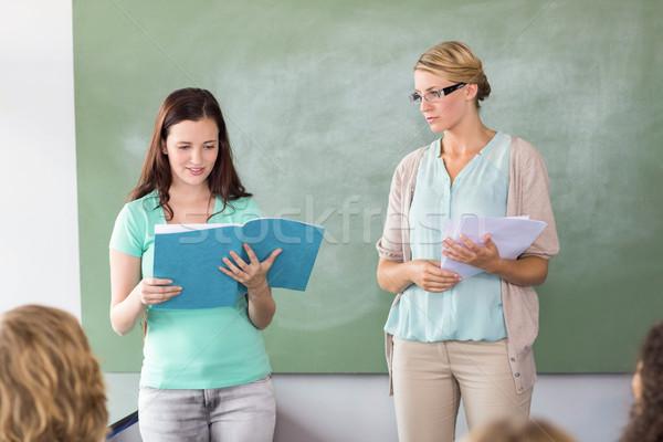 Student explaining notes besides teacher in class Stock photo © wavebreak_media