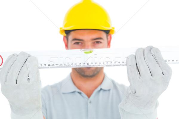 Portrait of handyman holding spirit level Stock photo © wavebreak_media