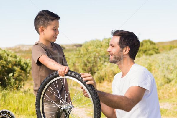 Syn ojca rowerów wraz człowiek Zdjęcia stock © wavebreak_media