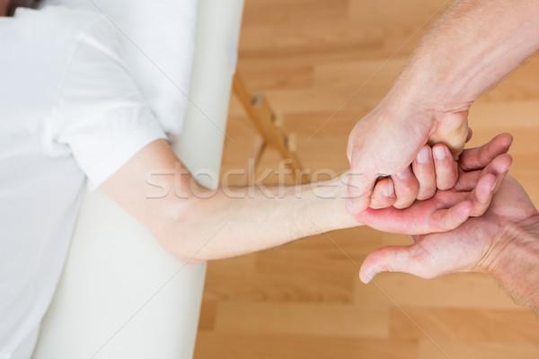 Physiotherapist doing hand massage  Stock photo © wavebreak_media